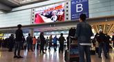 首都机场候机楼直播十九大开幕会 首都群众谈感受