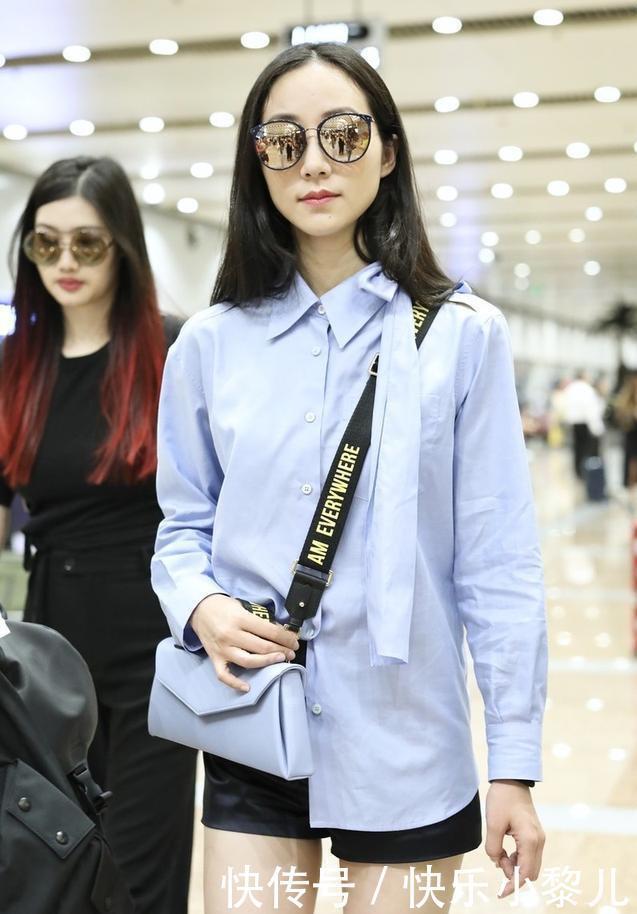 韩雪现身机场,蓝色衬衫搭配时尚热裤,墨镜加持尽显气质范