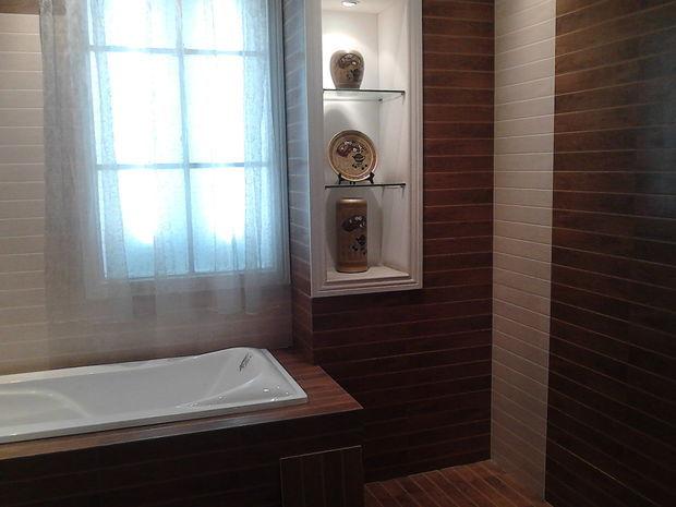 卫生间要装修了 个人觉得木地板的纹理漂亮 可是都说卫生间要选瓷砖