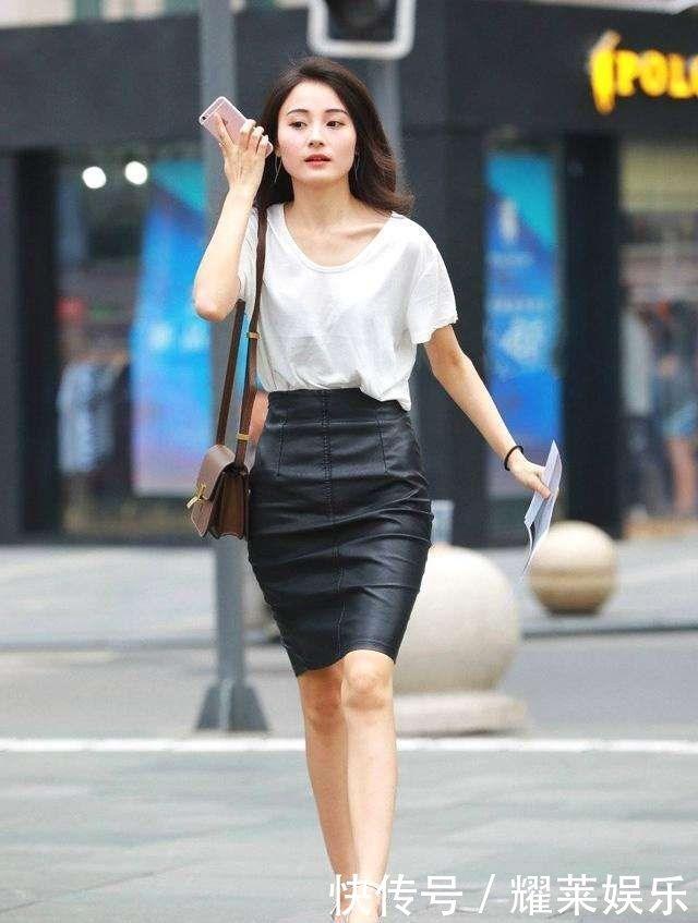 街拍时尚性感白色美女包臀皮裙,上衣气质,散发吻了美女被男人图片