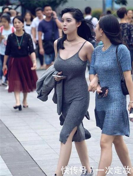路人街拍,迷人性感的美女,勾画出腿部的曲线线条